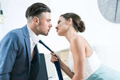 passionate businesswoman seducing boss at office