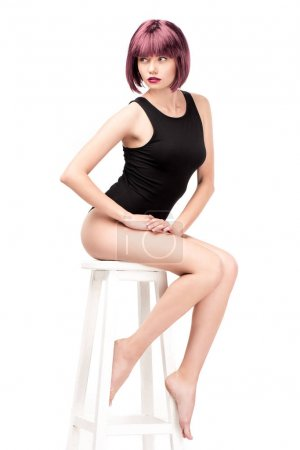 Girl with purple hair posing on chair