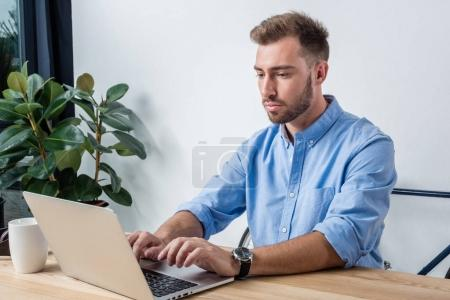 businessman with laptop in office