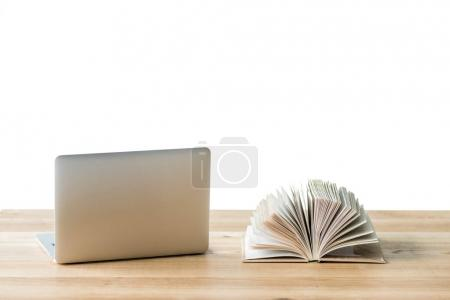 laptop and book on table