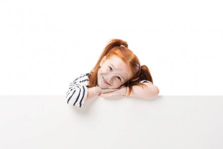 Photo for Adorable happy little redhead girl posing with blank banner isolated on white - Royalty Free Image