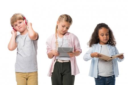 children with gadgets and book