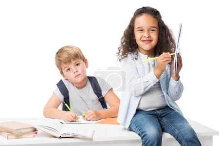 multiethnic schoolkids studying together