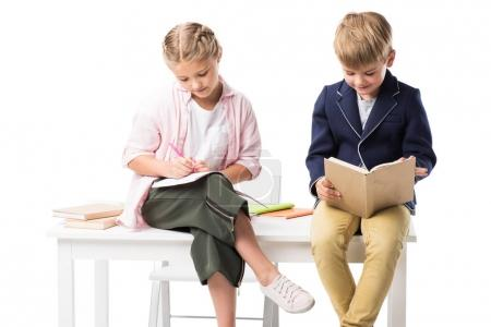 Adorable schoolkids studying together