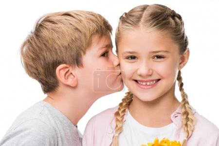 Photo for Close-up portrait of cute little boy kissing happy girl isolated on white - Royalty Free Image