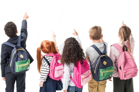 Photo for Back view of multiethnic children with backpacks pointing at copy space isolated on white - Royalty Free Image