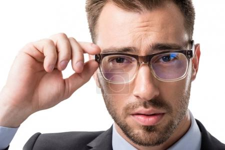 Photo for Portrait of young businessman in eyeglasses looking at camera isolated on white - Royalty Free Image
