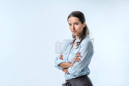 Photo for Portrait of young confident businesswoman in formal wear looking at camera isolated on blue - Royalty Free Image