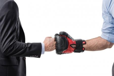 businessman and boxer shaking hands