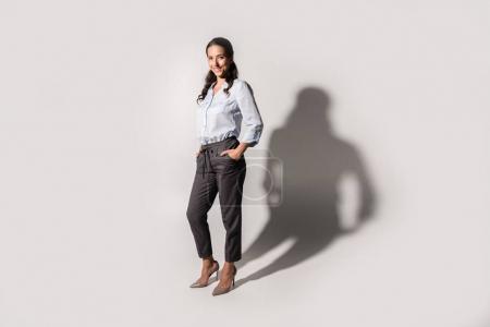 smiling businesswoman in formal wear