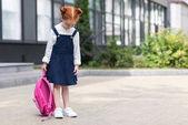 redhead schoolgirl with backpack