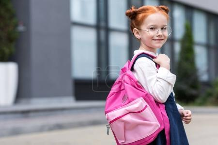 redhead schoolgirl with backpack
