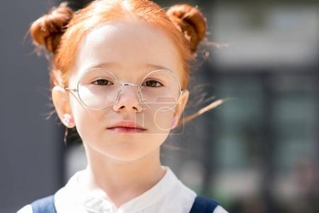 redhead girl in eyeglasses