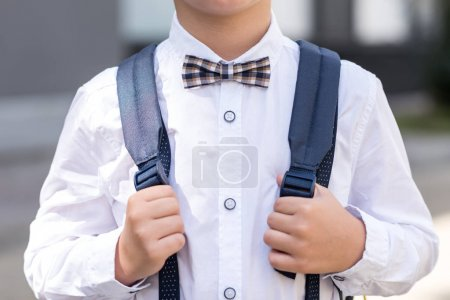 stylish schoolboy with backpack