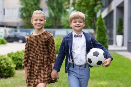 schoolboy and schoolgirl standing together