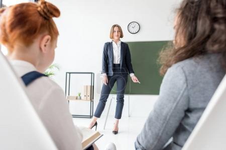 Teacher explaining lesson to students