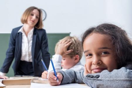teacher and schoolchildren at lesson