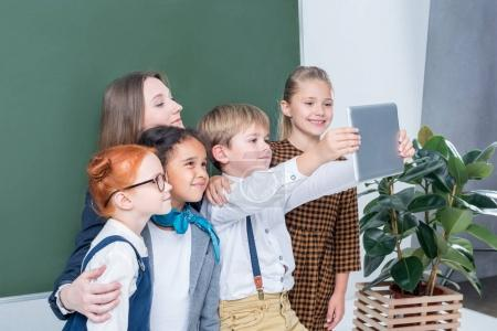 teacher with students taking selfie