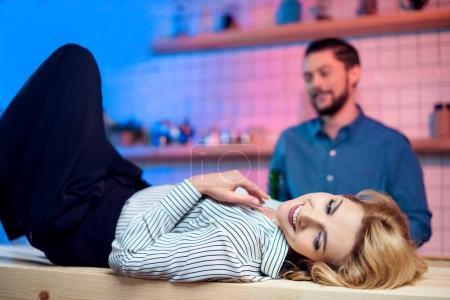 Woman flirting with bartender