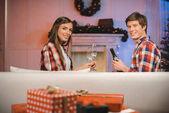 couple celebrating christmas at home