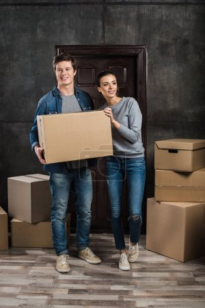 couple holding cardboard box together