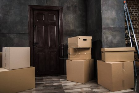 cardboard boxes in room