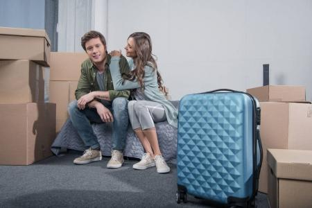 couple sitting on bed at home