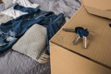 Photo for Close up view of keys from apartment on cardboard box - Royalty Free Image