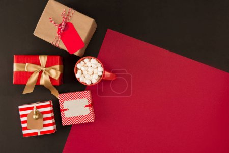 Christmas gifts and beverage with marshmallows