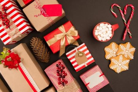 Photo for Top view of christmas gifts, cookies, candy canes and hot beverage with marshmallows - Royalty Free Image