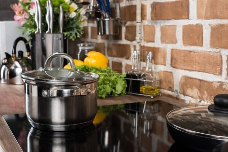 Photo for Close up view of saucepan on stove in kitchen - Royalty Free Image