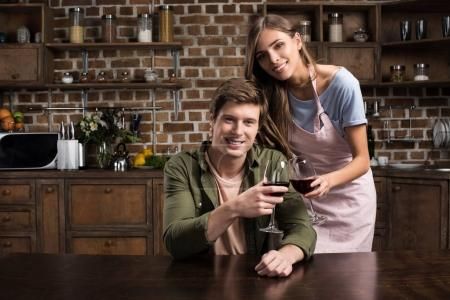 couple clinking glasses on wine
