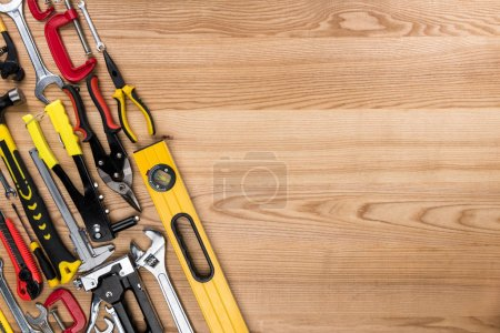 Photo for Top view shot of composition with various reparement tools on wooden surface - Royalty Free Image