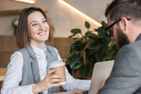 Photo for Young successful business partners drinking coffee at cafe - Royalty Free Image