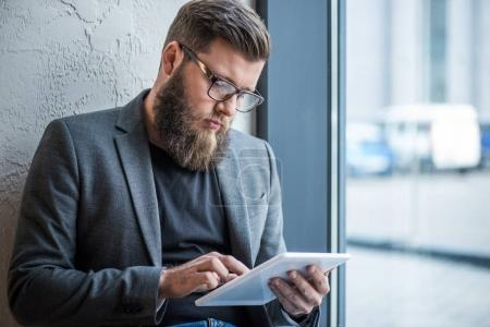Photo for Handsome bearded businessman using tablet - Royalty Free Image