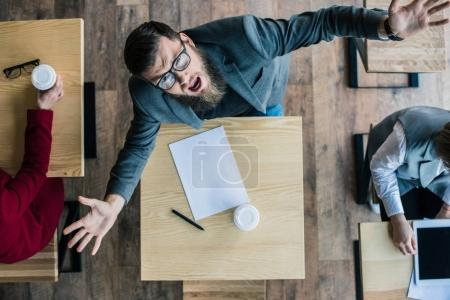 businessman shouting at camera