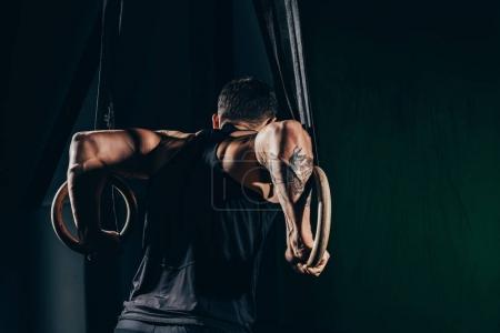 sportsman on gymnastic rings
