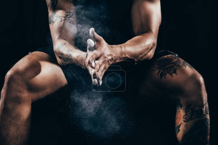 sportsman applying talcum to hands