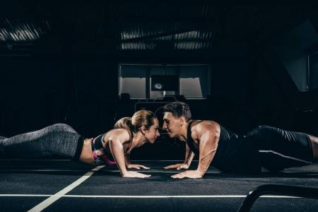Fit couple doing push ups