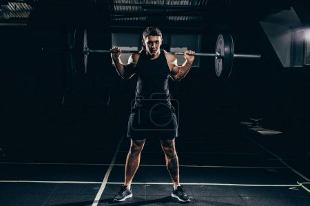 sportsman lifting a barbell