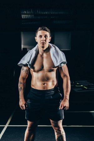 Fit shirtless sportsman
