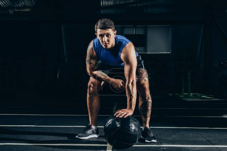 sportsman with weighted ball