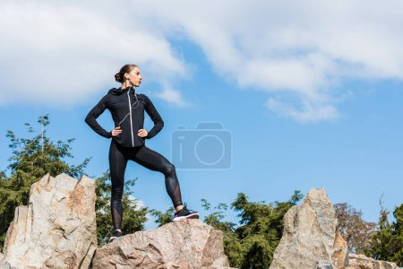 young sportive woman on rocks