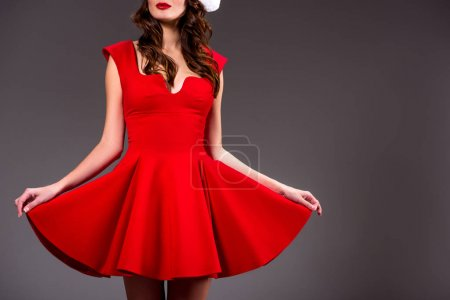 Photo for Cropped view of beautiful girl posing in red dress, isolated on grey - Royalty Free Image