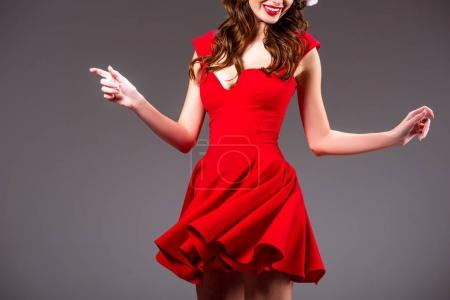 Photo for Cropped view of beautiful girl dancing in red dress, isolated on grey - Royalty Free Image