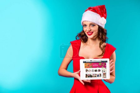 girl with amazon on tablet on christmas