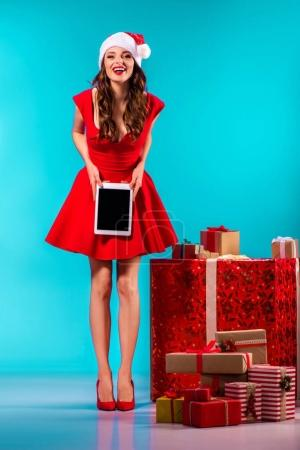 santa girl presenting tablet