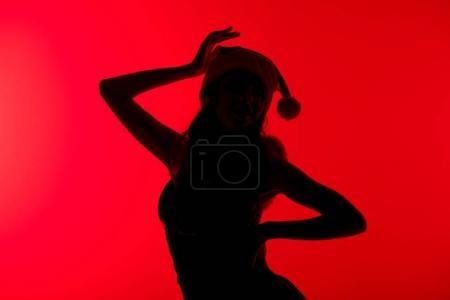 Silhouette of girl in santa costume