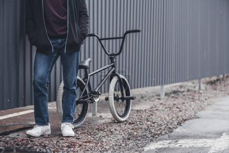 bmx biker with bicycle