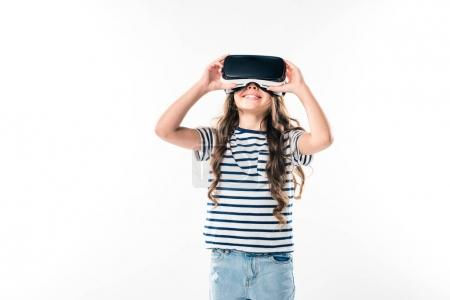 Photo for Preschooler kid watching something with VR headset isolated on white - Royalty Free Image